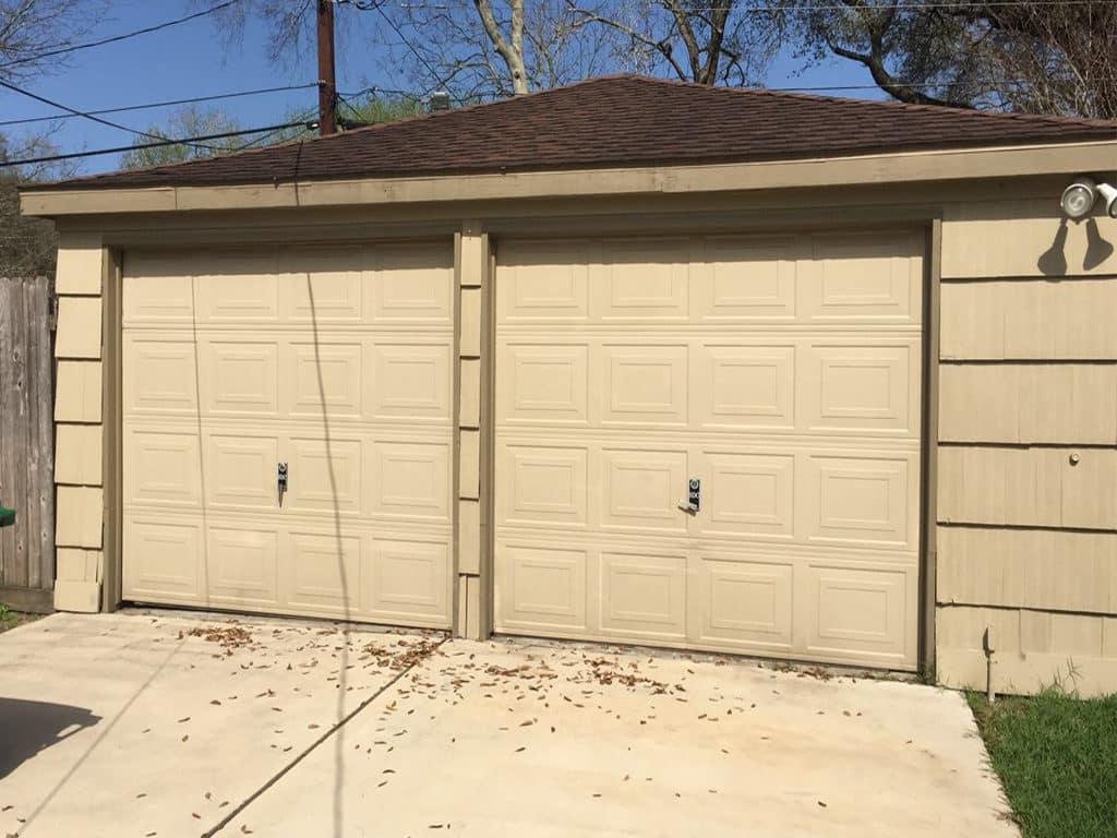 2 garage doors to1conversion-before